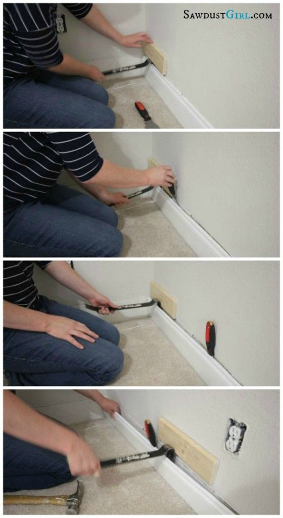 How to remove baseboard and trim without damaging your wall or moulding -- our baseboards are impossible to remove but this method does help!