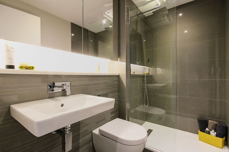 Contemporary bathroom with double shower from our factory conversion project in London's Southbank. See more of our work at http://www.janeclayton.co.uk/design-service/