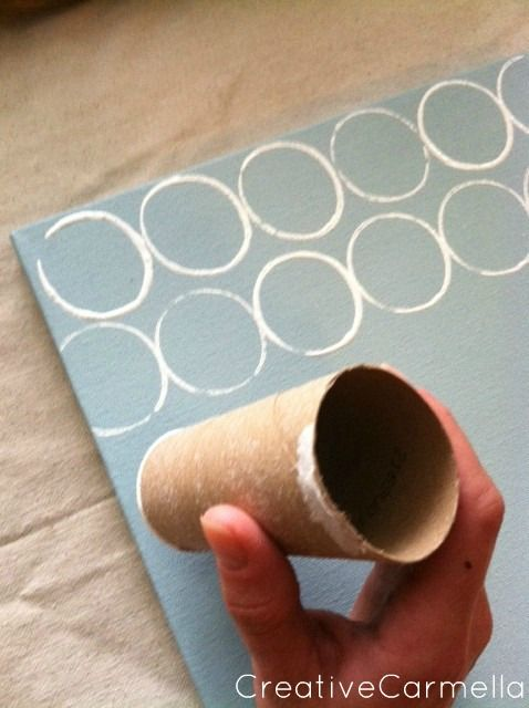 Toilet Paper Roll Painting Overlap the circles, different shades of color, cover the end with a paper towel and rubber band and make some circles solid...