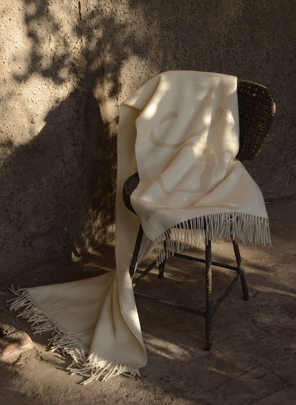 Good intentions baby alpaca throw. Pure natural baby alpaca throw with words of wonder..