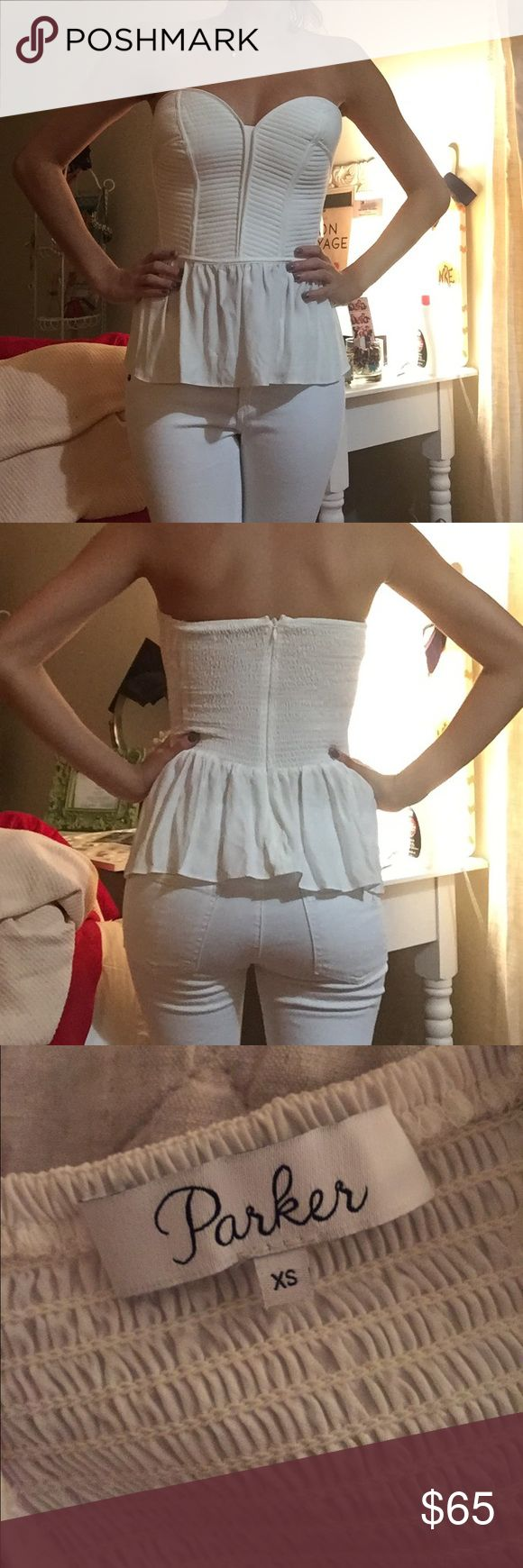 Parker Strapless Bustier Top Worn once and in amazing condition. This strapless silk top features a sweetheart neckline and a topstitched, boned bodice. Puched peplum. Revolve Tops Blouses