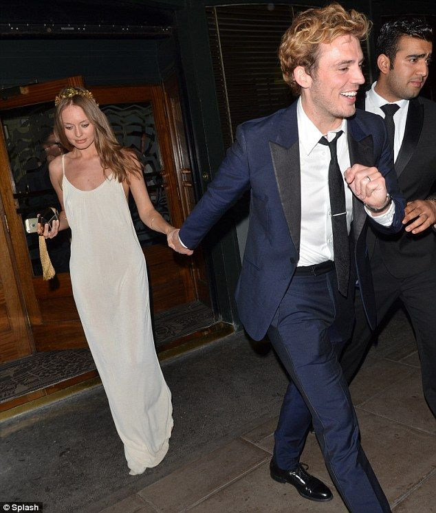 Sam Claflin Laura Haddock.  I pinned this because Sam looks like an excited toddler in this picture and it made my day
