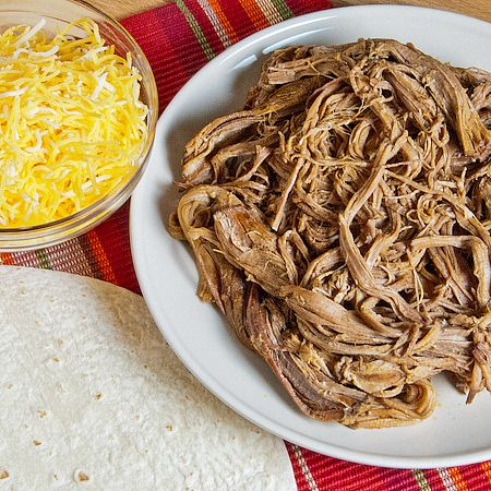 crockpot Mexican Shredded Beef (chuck roast, beef broth, lime juice, spices) -- easy to make for tacos, burritos, tostadas, etc.