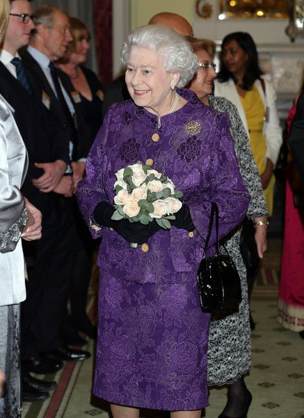 Queen Elizabeth II attends a reception to mark Commonwealth Day at Marlborough House on March 9, 2015 in London, England.