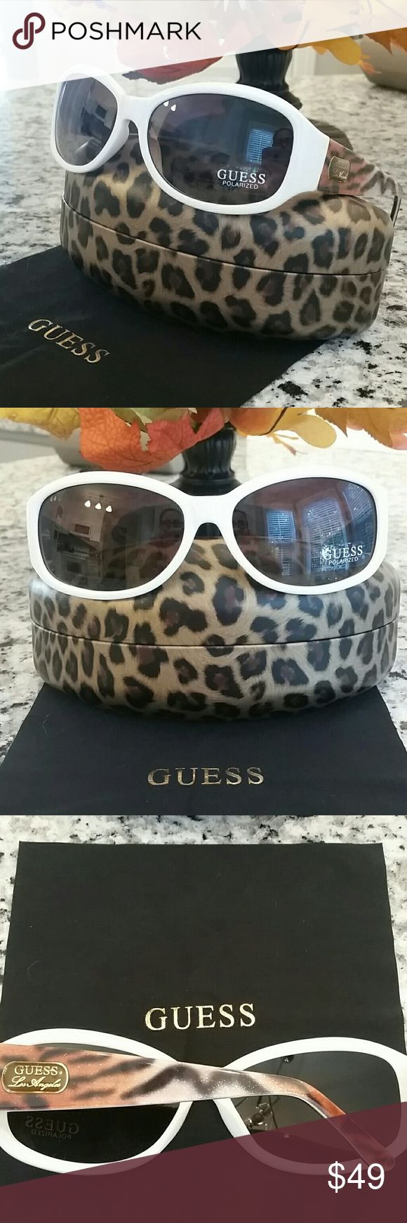 Guess white and tiger polarized sunglasses NWT Guess polarized sunglasses. Go Hollywood glam with these Los Angeles ladies' shades from the stylish Guess brand! The smooth white rectangle frame with tiger stripe arms in glittering finish create an ultra fabulous accessory that will enhance any outfit! Guess Accessories Sunglasses