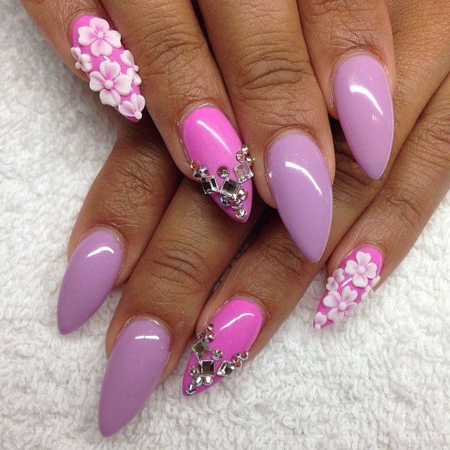 purple and pink stiletto with white flowers and jewels nail art design