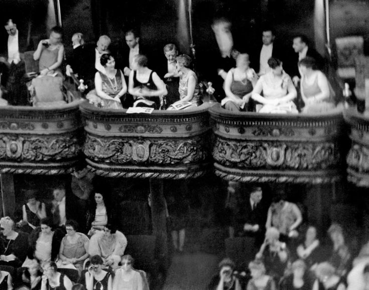 """October 28, 1929 - The night before the """"Black Tuesday"""" stock market crash. """"The Dowager Mrs. Cornelieus Vanderbilt"""" and guests sit in the Diamond Horseshoe tiers of boxes on opening night of Puccini's Manon Lescaut at the Metropolitan Opera House, NY"""