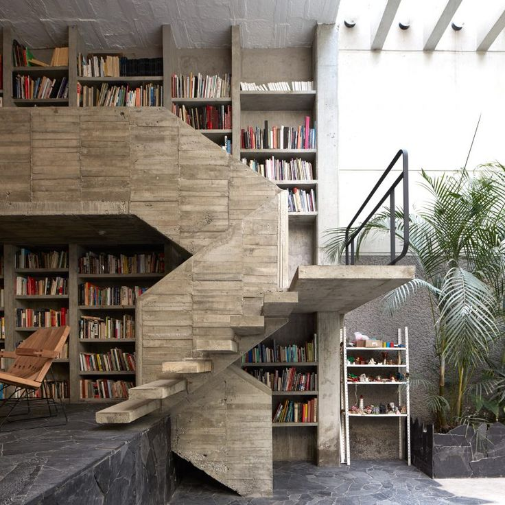 The Mexico City home and studio of Mexican sculptor Pedro Reyes and his fashion-designer wife Carla Fernandez features crazy paving floors, as well as a staircase and double-height library rendered in coarse concrete.