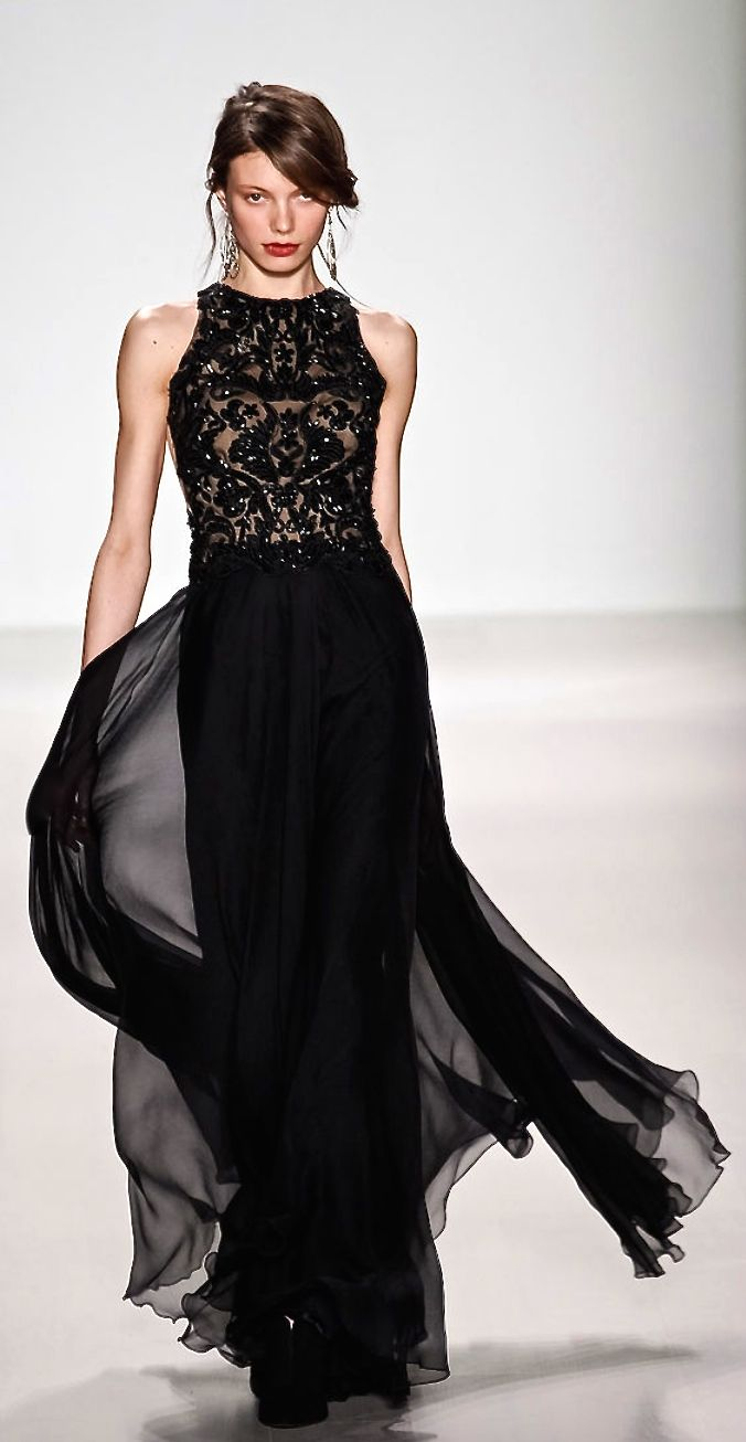 Christian Dior. Dig the style and flow. Would love to see this in some other jewel tones. Would be stunning.