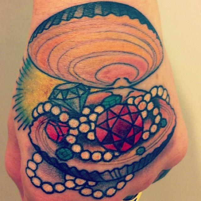Sea shell with diamond tattoo