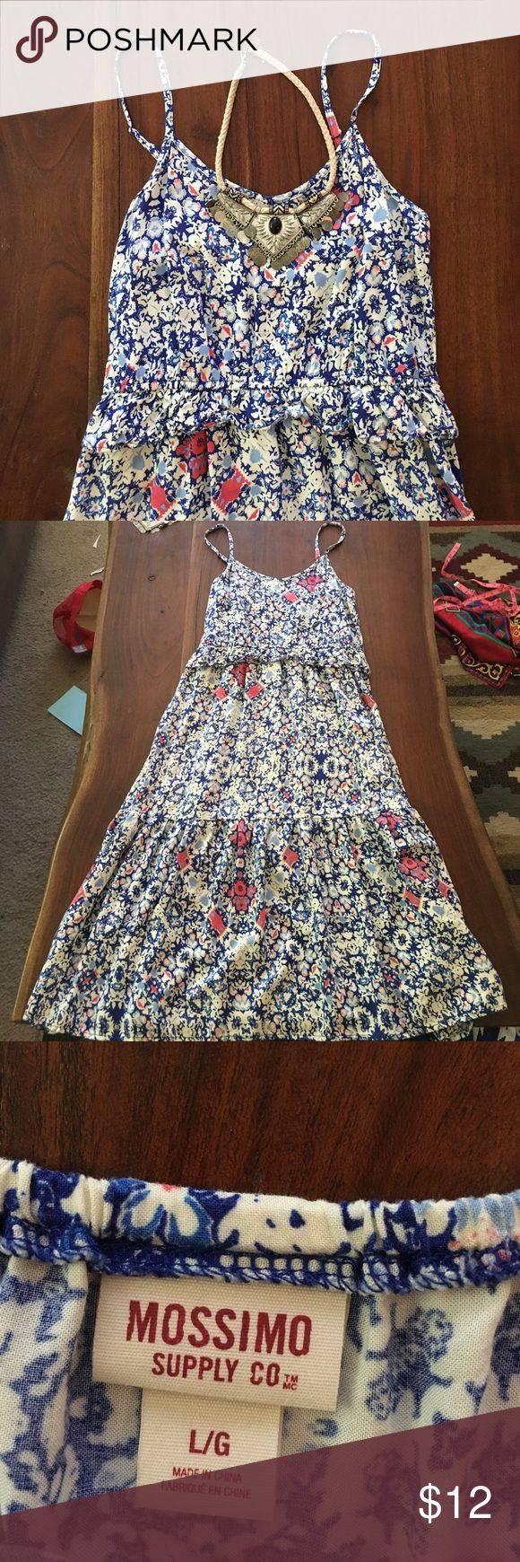 Blue and white summer dress This float boho dress is perfect for a day you are going to be out and about and you don't want to mess with your outfit the whole day. Soft fabric and casual fit, perfect to dress up with some accessories! Will fit a medium as well as large. Straps are adjustable length is 43 inches. Dresses