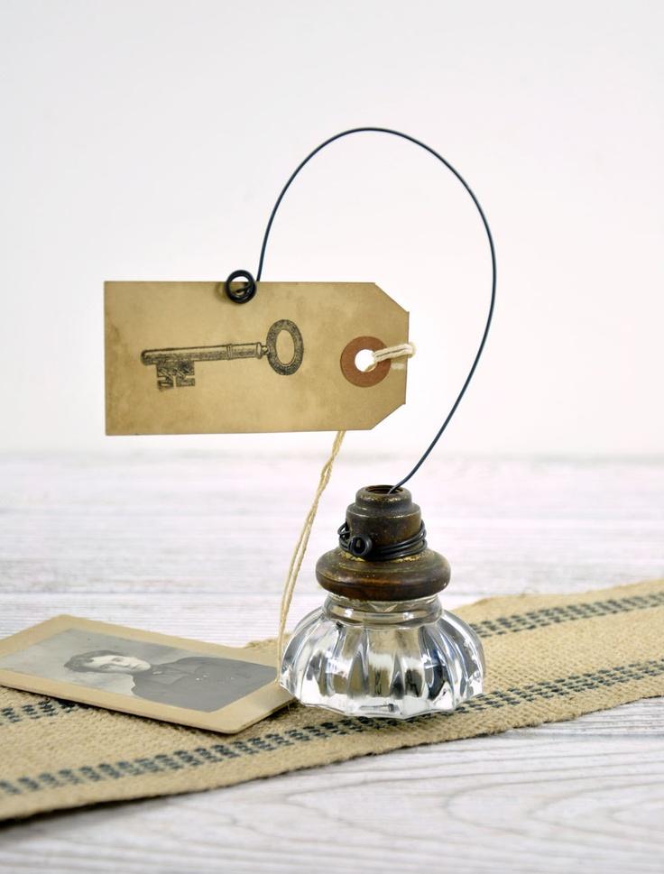 Vintage Door Knob Photo Holder / Wire Picture or Card Holder. $18.00, via Etsy.