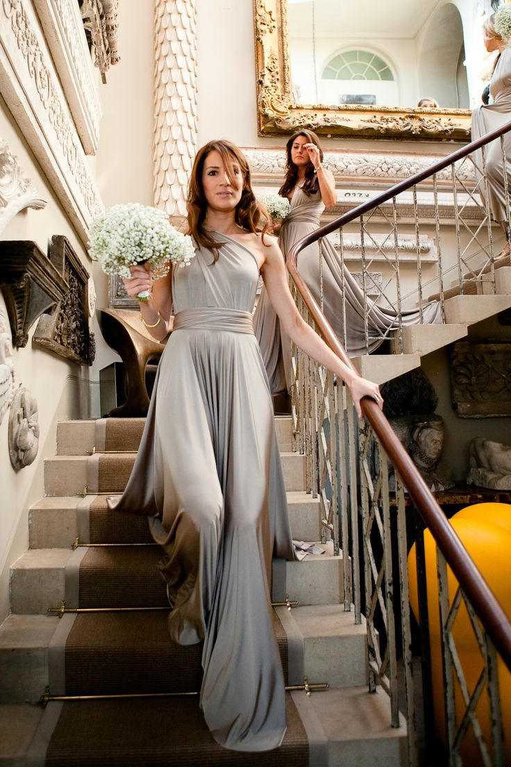 A maid looking stunning in our Putty ballgown tied in the one shoulder style