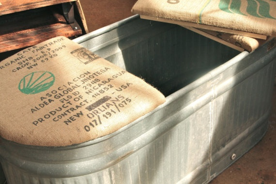 Galvanized Stock Tank Adapted to Bench w/Burlap- good idea for all those troughs that have holes at the bottom!