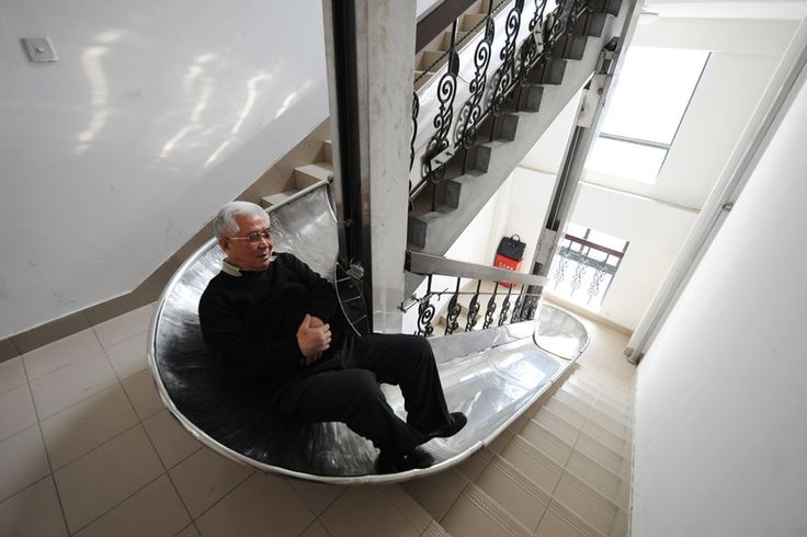 70-year-old inventor Zhou Miaorong tries out an evacuation slide he built himself in a building in Shanghai