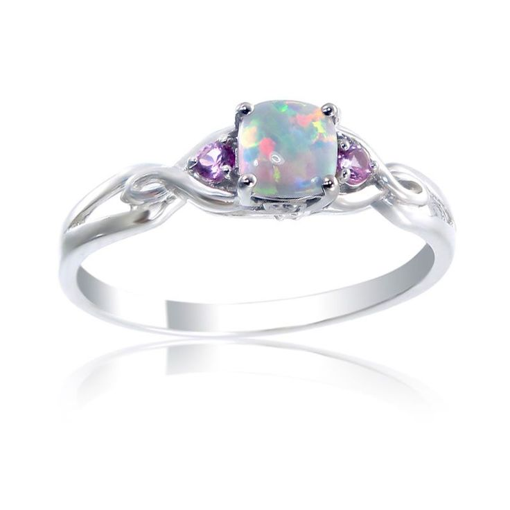 This ring is set in sterling silver with a 5x5mm cushion-cut created opal stone, two 2mm brilliant-cut created pink sapphire stones, and two diamond accent