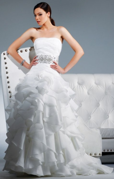 David Tutera - Chelsea  Kind of funny the dress is named Chelsea and so is my sister, and she works in a bridal store...