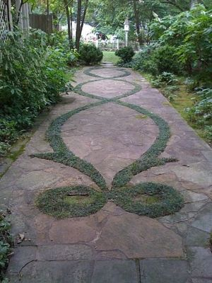 Moss creates a beautiful pattern in a garden path made of blue slate