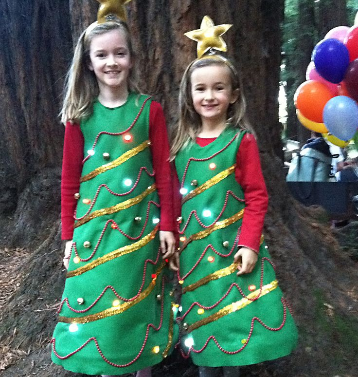 It can be Christmas all year long with these adorable light-up Christmas tree costumes. With almost no electronics or sewing experience, and a little curiosity and patience, this is a costume that can be done in an afternoon or weekend. The electronic component requires a handful of 10mm LEDs, some stranded wire, a AA battery pack, and soldering iron. The crafting component uses a few yards of green felt, a sewing machine (if handy), hot glue gun, and some decorative elemen...