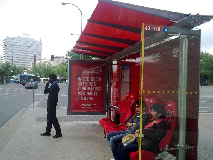 Bus stop with Real Madrid bench at Santiago Bernabeu corner done by TV football cable (Gol TV).  Parada del autobus con los asientos del banquillo del Real Madrid junto al estadio Santiago Bernabeu para promocionar una televisión de futbol de pago (Gol TV).