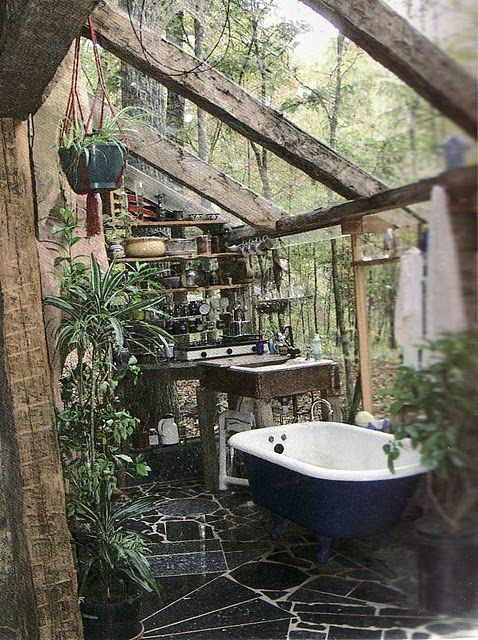 This is fantastic. I would lay in that bath for hours watching it rain on the roof above.