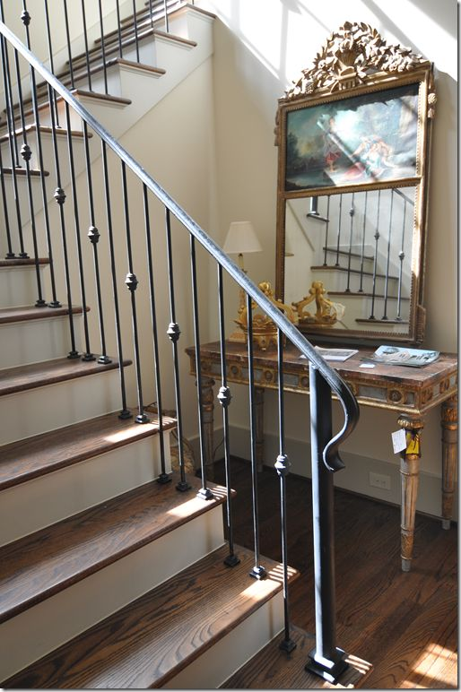 stair railing. Love this staircase. Iron banister, oak treads, white risers...