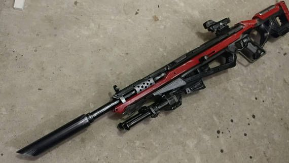 A stock nerf raptorstrike with a barrel extension  Its