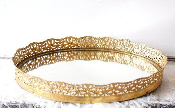 Still hoping for something similar. Vintage Gold Filigree Vanity Mirror Tray by BohemianLil on Etsy, (sold out) $22.00