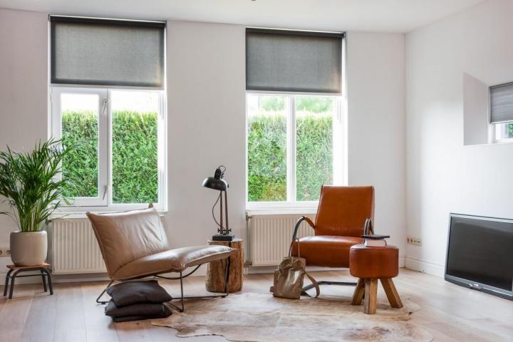 rolgordijnen in de woonkamer | Raamidee