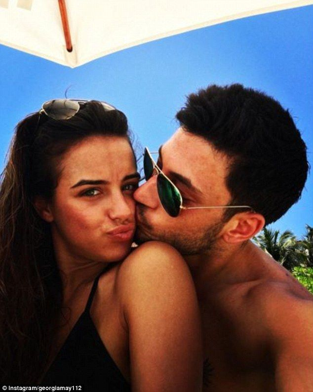 Smitten kittens: It looks like romance is aplenty on Georgia May Foote's idyllic getaway with boyfriend Giovanni Pernice as the former Coronation Street star shared an amorous snap of the two putting on a doting display while resting poolside in the Maldives on Wednesday