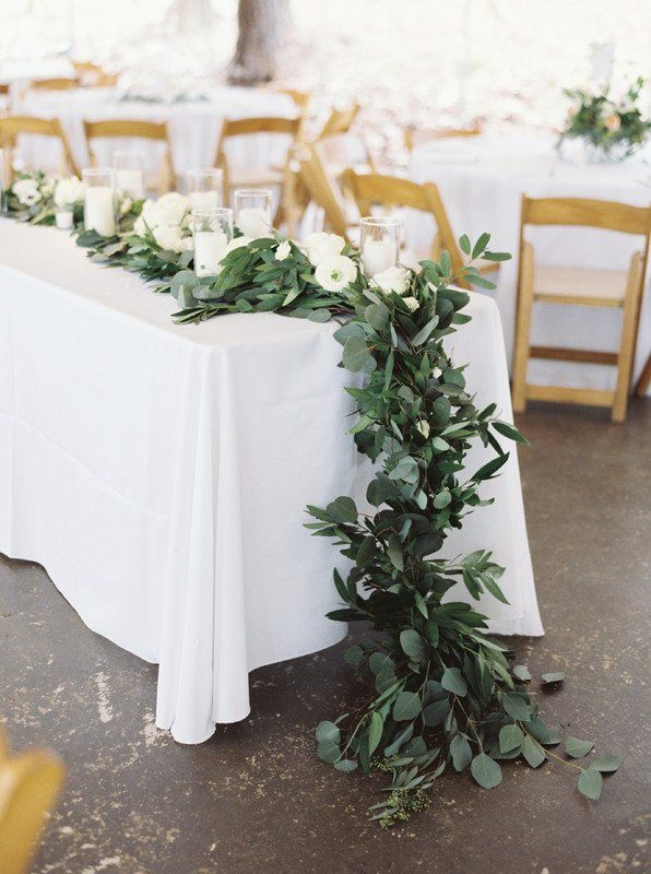 Greeney wedding reception decor idea - white table linens with greenery garland and votive candles {Anik Flowers}