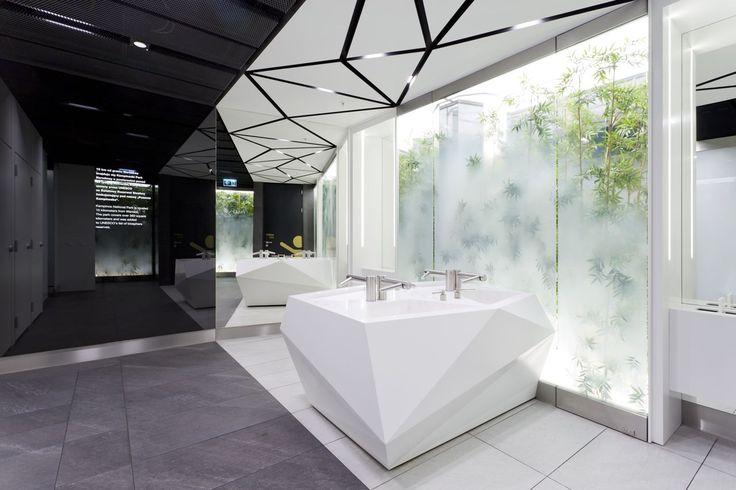 Design of the interior for public toilets and corridors in SC Złote Tarasy, stage 02. #geometric #minimal #zlotetarasy #architecture #design #interiors #art #light #plants #white #black