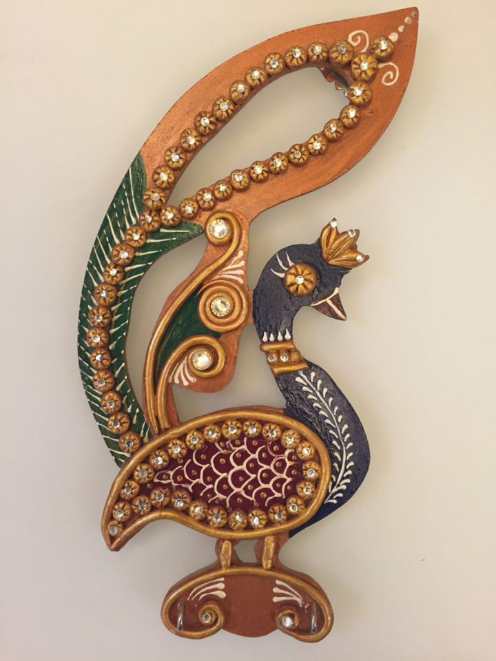 Peacock with its wings spread out Hand crafted key holders. Material used wood