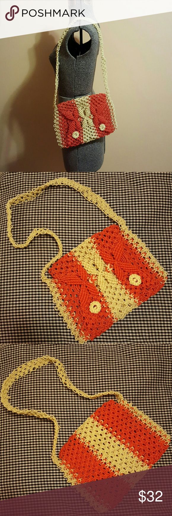 Vintage Red and Cream Crocheted Purse Vintage homemade orangish red and cream shoulder bag. Crocheted with a rigid waxy cord material. Has a single pocket with 2 floral buttons that keep flap closed. Measures about 11.5 x 9 inches. Strap measures 13 inches at its longest. Fantastic condition without any notable flaws. Vintage Bags Shoulder Bags