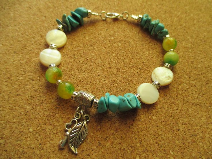 A pretty handmade bracelet with a  combination of mother of pearl beads, jade and turquoise chips. Especially for those who are searching for knowledge, creativity and imagination.
