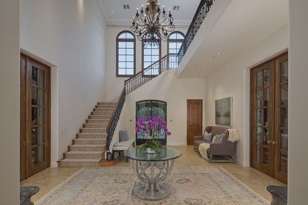 | Inside Heidi Klum's Brentwood Estate | The double-height entrance hall opens to the main living areas, including the living and dining rooms.