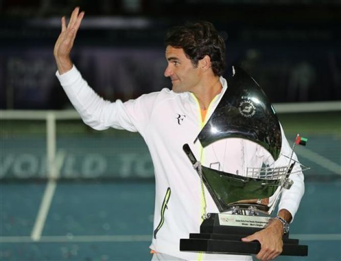 Roger Federer Trophy Selfie: ´Everything is Easier When You Win´ | He won his 7th Dubai Championship beating Novak Djokovic 6-3 7-5, Feb 2015.