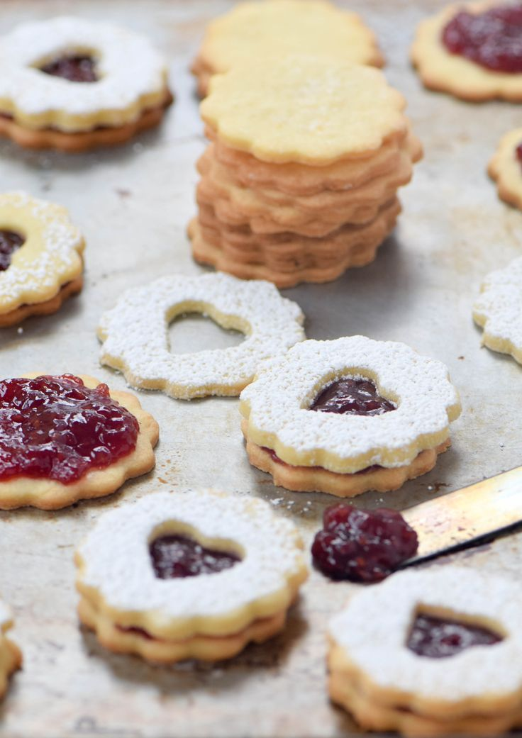 Homemade Valentine's Day love in the form of a heart-shaped Linzer cookie filled with red raspberry jam. An authentic, Old World, nut-free recipe.