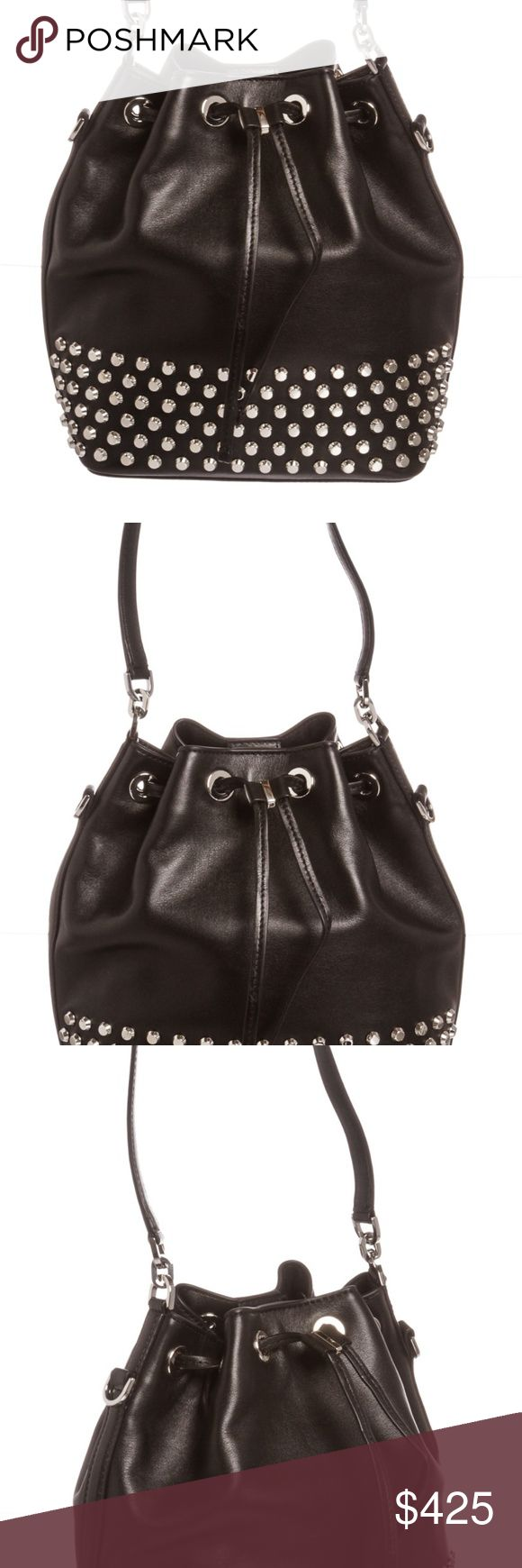 Michael Kors Black Leather Dottie Large Bucket Bag Black Michael Kors leather studded Dottie large bucket bag with tonal fabric lining, three interior pockets one with a zipper closure, removable crossbody strap and interior key clip.  Drawstring and snap closure.   6178MSC Michael Kors Bags Shoulder Bags