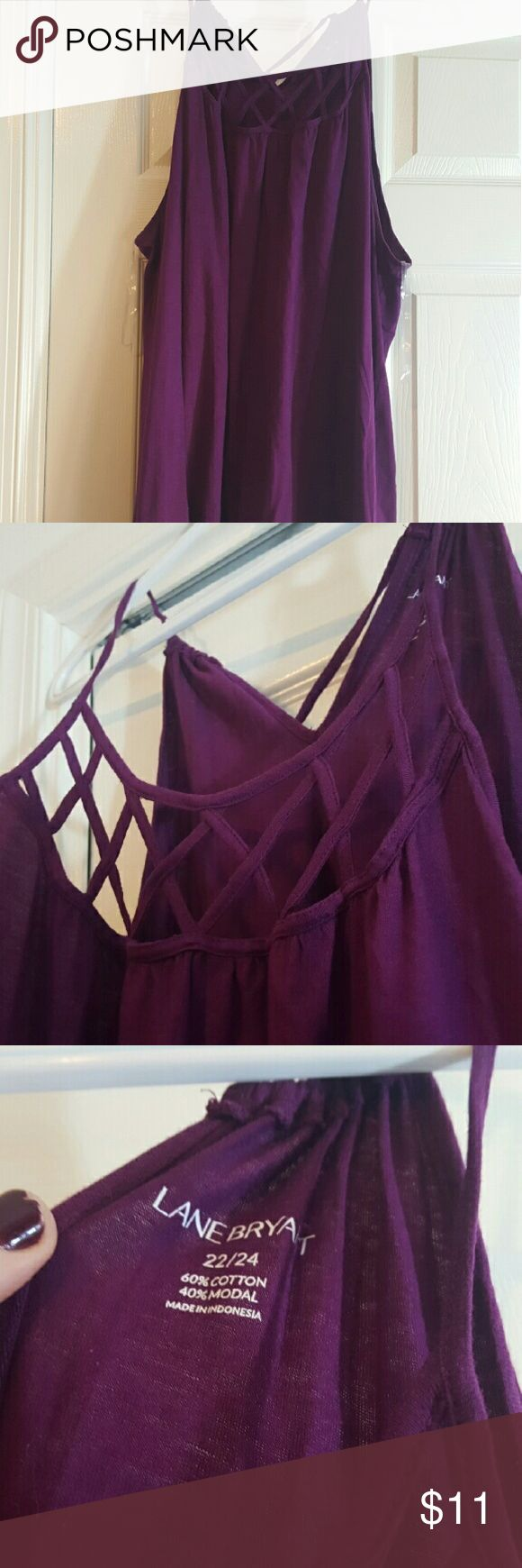 Lane Bryant Purple Strappy Tank top Size: 22/24 Color: Purple Lane Bryant Purple Strappy Tank top. Has adjustable tie in back with beads on ends. Moderately worn. Lane Bryant Tops Tank Tops