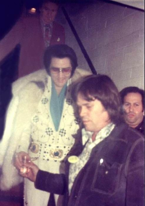 Elvis leaving his hotel for his Hampton roads concert in march 11 1974 with Joe Esposito behind Sonny West.