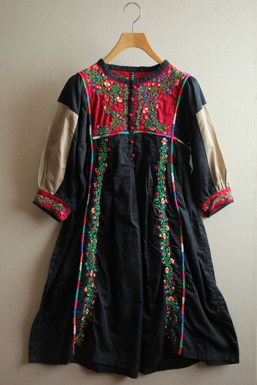Vintage? It's from a Tumblr and just labeled Bohemian Life, but with no source; it could be from somewhere in S Asia or Middle East, but embroidery looks more E European ... handcrafted contemporary with vintage elements/cultural fusion? All theories welcome :-)