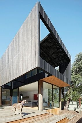 NIXON TULLOCH FORTEV ARCHITECTURE A wall of vertical timber battens shades the interior and screens views.