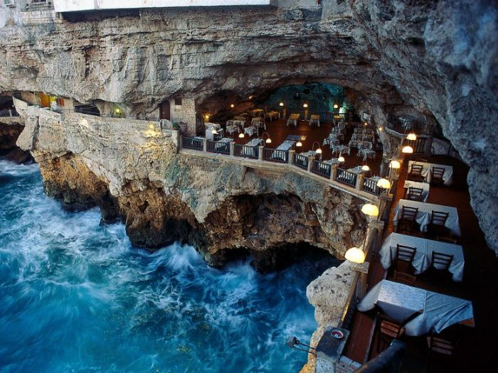 Ristorante Grotta Palazzese | Puglia, Italy | This resort hotel consists of suites and this luxurious restaurant carved out of solid rock and overlooking the water. They could serve hot dogs - I want to go here.