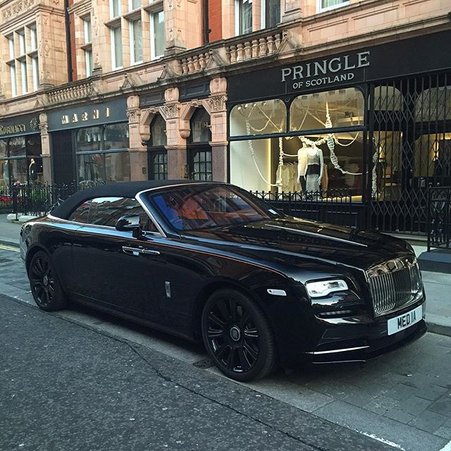 2016 Rolls-Royce Dawn, as seen in Mount Street, Mayfair W1: Twin-turbo 6.6-litre V12; produces 563bhp at 5250rpm, 575lb at 1500rpm, driving the rear wheels through an 8-speed ZF automatic gearbox, which links with the sat-nav to automatically pre-select the next appropriate gear. It can get from 0-62mph in 4.9sec, and reach a limited 155mph. Combined fuel economy: 19.9mpg; CO2 emissions: 330g/km. It is 5285mm long, 1947mm wide, 1502mm high, wheelbase: 3112mm; weight: 2560kg. Price: £250,000.