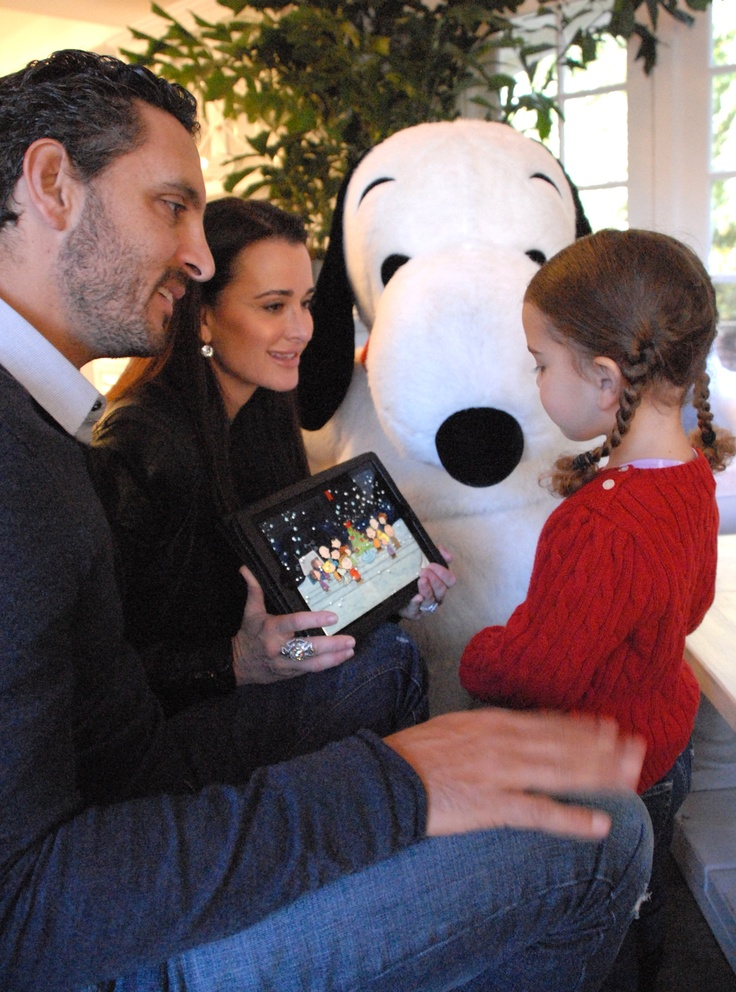 Kylie Richards and Snoopy with Husband and Daughter