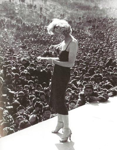 Marilyn Monroe with american soldiers during Korean War -James Lescott.