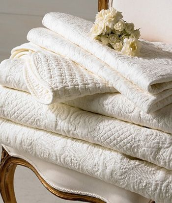 My preferred bed coverings. Simple, beautiful and elegant.   white, embossed quilts~❥