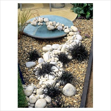 Dry pebble stream with Ophiopogon