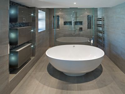 super contemporary oval bathtub with oversized tiles, wall detailing and large walk in shower